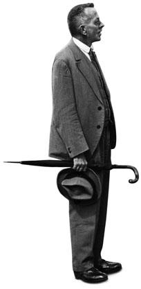 Con paraguas perpendicular a su figura erecta